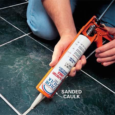 <b>Remove the old grout and replace it with caulk</b></br> <p>Remove all the loose and cracked grout with a grout saw or Dremel tool and completely vacuum out the gaps. Then apply the caulk and smooth it with a wet finger or plastic spoon.</p>