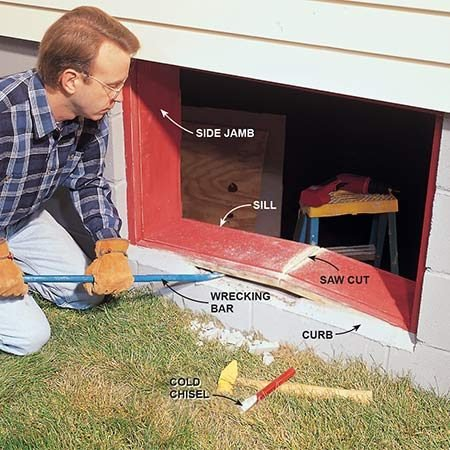 """<b>Photo 1: Rip out the old jamb</b></br> Pry out the old window jamb with a wrecking bar. First cut the wood sill with a handsaw or circular saw. Be careful not to cut all the way through to the concrete or you'll ruin the saw blade. Then rip out the sill, the side jambs and the head jamb. Our sill sat against a sloped mortar """"curb,"""" which we had to chip away with a cold chisel before we could cut and pry the sill."""