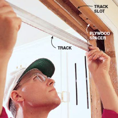 Installing new track when repairing a pocket door.