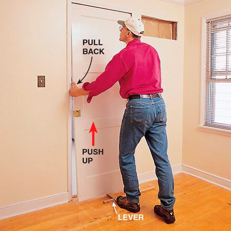 <b>Rehang the door</b></br> <p>Rehang the door by angling the bottom toward you, lifting up with a lever, and pulling back on the top of the door to hook the rollers onto the track.</p>