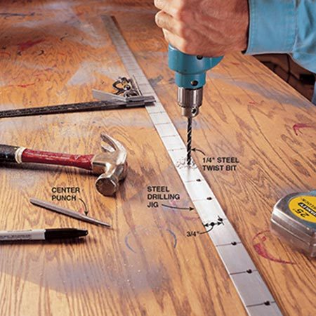 <b>Photo 4: Make a jig for shelf holes</b></br> <p>Make a jig to drill accurate holes for the shelf-support hardware. Drill 1/4-in. dia. holes 2 in. apart and centered 3/4 in. from the edge into a 1-1/4 in. x 1/8-in. x 6-ft. piece of mild steel.</p>