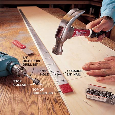 <b>Photo 5: Drill the shelf support holes</b></br> <p>Nail the jig (use 3/4-in. nails) to the plywood pieces (A and A1) you've already cut. The jig needs four 1/16-in. holes along its length for the small 3/4-in. nails that attach it to the plywood (see Fig. B). Once the jig is secure to the plywood piece, drill 1/4-in. holes 1/2 in. deep through each of the jig holes into the plywood.</p>  <p><b>NOTE</b>: The two outside end panels (A2) do not have holes drilled into them.</p>