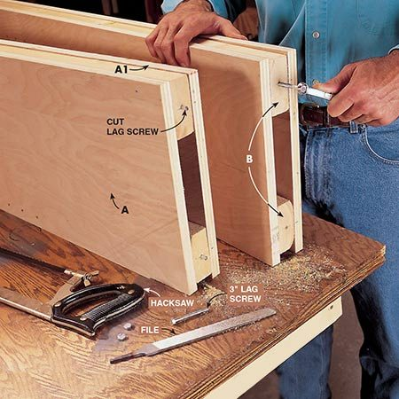 <b>Photo 7: Install pins in standards</b></br> <p>Install a pair of 3-in lag screws in the bottom of each standard. Use a wrench to turn them until the threads are all inside the bottoms of the 2x4s. Next, cut the heads off the screws with a hacksaw and file a slight taper on the bottom of the protruding screw shaft. These pins will hold the standards into holes in the floor (to be drilled later).</p>