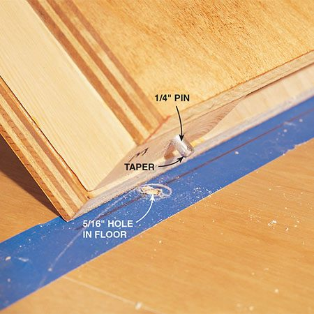 <b>Photo 11b: Align pins with holes</b></br> <p>File the ends of the steel pins so they slide easily into the holes in the floor.</p>
