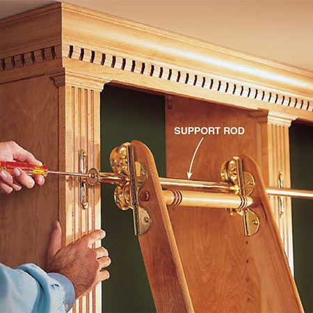 <b>Photo 17: Attach the rolling ladder</b></br> <p>Install the rolling ladder hardware to the face of the cabinet according to the manufacturer's instructions.</p>