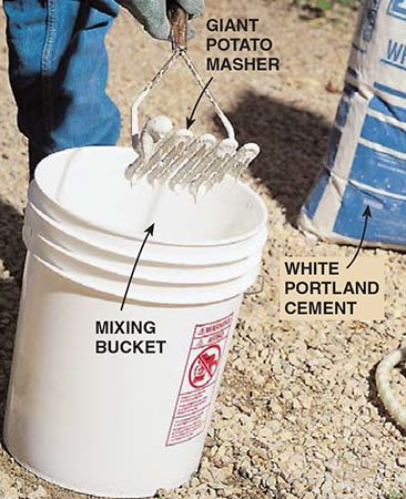 <b>Mix the stucco</b></br> <p>Mix white Portland cement and water in a pail to the consistency of pancake batter. A giant potato masher works well for this job.</p>