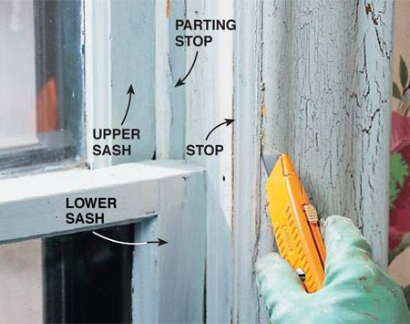 <b>Photo 5: Pry off the stop</b></br> <p> Score the stop/trim joint with a utility knife to prevent chipping. Then pry off the stop and remove the inner sash, the parting stop and the outer sash so you can strip the paint from the sliding surfaces. It's often easier to replace the parting stop and the stop with new wood.</p>