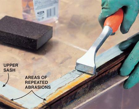 <b>Photo 9: Scrape the sash edges</b><br/><p> Scrape paint completely from the sliding edges of the sashes and stops (or buy new stops). Work on a poly-covered work surface in the same room or on an extra layer of poly on the floor.</p>
