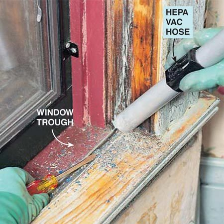<b>Photo 10: Vacuum everything</b><br/><p> Vacuum the entire work area with a HEPA vacuum (see Photo 15) to pick up paint chips and dust. Use the tip of a screwdriver to dig sludge and chips out of cracks and corners, especially around the window trough.</p>