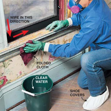 <b>Photo 13: Rinse with clean water</b></br> <p> Rinse the entire project with a cloth and clean water, again starting from the top and working downward. Wipe horizontal surfaces in one direction. Refold the cloth to expose a clean surface after each wipe. Rinse the cloth in the bucket of water and change the water often.</p>