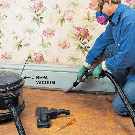 <b>Photo 15: Vacuum thoroughly</b><br/><p>Vacuum the floor with a HEPA vac, working carefully into corners and along edges. Be especially thorough on old wood floors with lots of cracks that hold dust.</p>