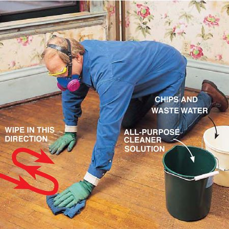 <b>Photo 16: Wash the floor</b></br> <p> Wash the floor with the all-purpose cleaner and a cloth. Reduce potential recontamination by moving the cloth so that the dirtiest edge is always the leading edge. Wring it out and shake paint chips into a second bucket. Change water often. Then rinse using the same technique.</p>