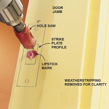 Marking the door jamb for the strike plate when installing a deadbolt lock.
