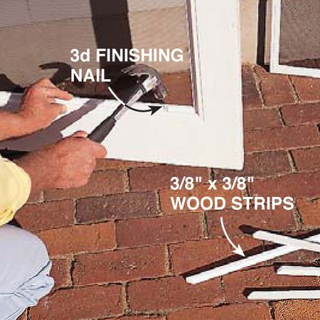 <b>Photo 13: Add screen frames</b></br> <p>Tack screen frames in place in the doors with 3/8-in. x 3/8-in. wood strips and 3d finishing nails.</p>