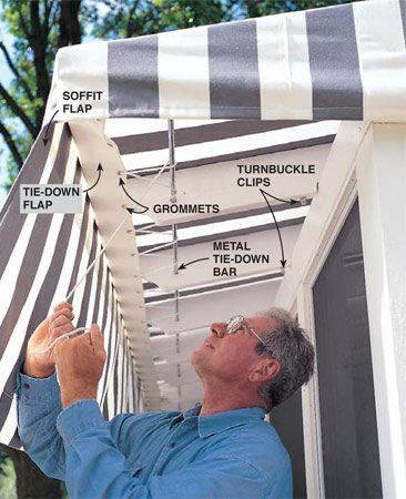 <b>Photo 15: Install the awning</b></br> <p>Secure the awning to the tie-down flap with rope. The tie-down flap, with grommets, and the soffit flap are sewn onto the inside front edge of our custom-made awning. The 1/2-in. dia. metal tie-down bar slides into place through holes drilled into the rafter ends.</p>