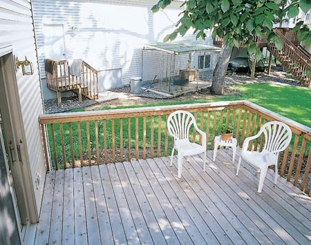 <b>Deck and railing before the fence</b></br> The deck location includes an unsightly view of the neighbor's backyard and dog pen.