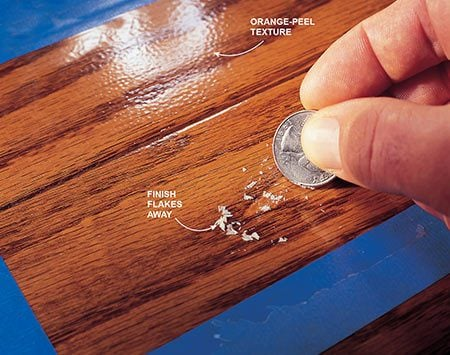 <b>Photo 3: Not suitable for refinishing</b></br> <p>If the finish flakes easily or is cracked or has an orange-peel look, you'll need to sand before refinishing the hardwood floor.</p>