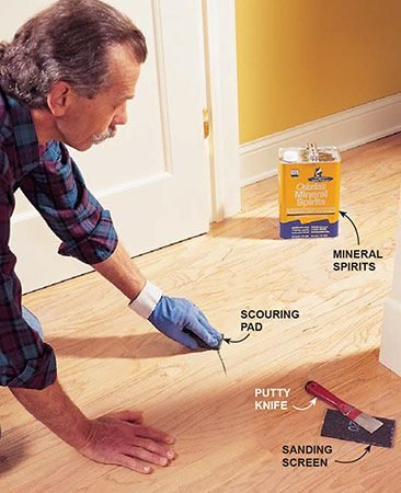 """<b>Photo 4: Clean the floor using a wood flooring cleaner</b></br> <p>A dull putty knife is handy for scraping up petrified chewing gum and other gunk. For tough marks, use a  scouring pad dampened with mineral spirits. If that fails, try sanding screen. As you clean, use pieces of masking tape to mark any deep scratches, ridges or areas where the finish has worn away. You'll have to give these trouble spots special attention (see """"Problems Areas"""" below).</p>"""