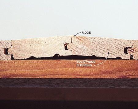 Flatten ridges before refinishing a hardwood floor.