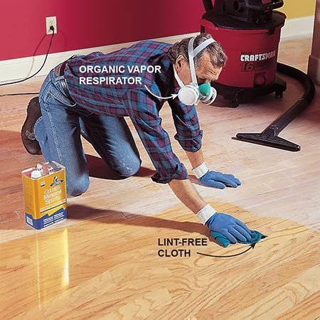 <b>Photo 10: Clean up the sawdust</b></br> <p>Vacuum thoroughly, then wipe the floor with mineral spirits to remove all the sanding dust.</p>