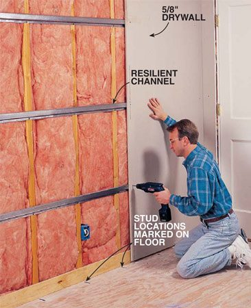 <b>Photo 7: Attach drywall</b></br> <p>Screw drywall to the channel's  flange with the drywall sheets running vertical. On ceilings, too, the sheets must run perpendicular to the channel. Use 1-1/4 in. fine-thread drywall screws spaced no more than 12 in. apart. <b>Important</b>: Screw into the channel, not into the studs. Mark the stud locations on the floor and ceiling so you can avoid them.</p>