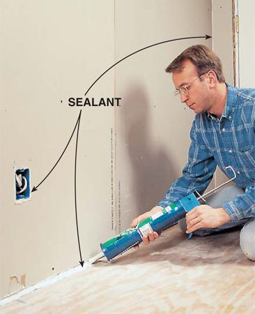 <b>Photo 8: Seal the edges</b></br> <p>Fill the gap between the floor and drywall with acoustical sealant or silicone caulk. Seal cracks at the corners where walls meet other walls or the ceiling, but scrape away the excess sealant with a putty knife so you can finish these corners with joint compound as you normally would. Also seal around electrical boxes.</p>