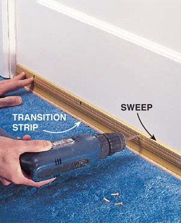 <b>Photo 11: Add a door sweep</b></br> <p>Screw a sweep to the back of the door, low enough so that it seals against the transition strip. If you have no need for a transition strip, you can use an <a href='http://www.amazon.com/Aluminum-Finish-Commercial-Medium-Duty-Automatic/dp/B000KZV1XA/ref=pd_cp_hi_2' rel='nofollow' target='_blank'>automatic door sweep</a>, available through our affiliation with <a href='http://www.amazon.com/Aluminum-Finish-Commercial-Medium-Duty-Automatic/dp/B000KZV1XA/ref=pd_cp_hi_2' rel='nofollow' target='_blank'>Amazon.com</a>, which rises above the floor when the door opens and drops down when the door is closed.</p>