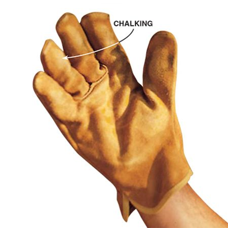 <b>Photo 1: Check for chalking</b></br> <p>Rub your hand over the painted surface and look for a powdery light-colored residue, the sure sign of chalking. Pressure-washing will scour it off to ensure a good bonding surface for the new coat.</p>