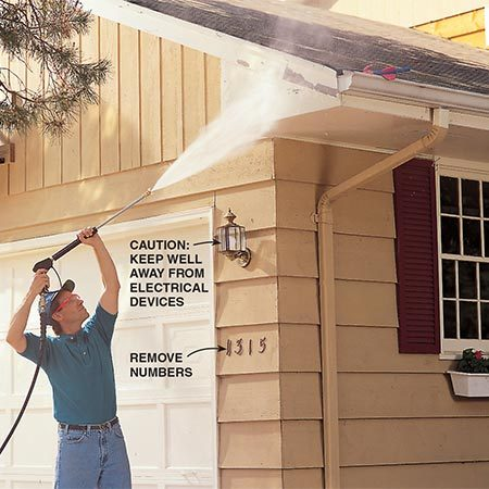 <b>Photo 5: Work from the top down</b></br> <p>Begin washing the walls at the top and work down. Wash the gutters and soffits as well as the siding. Direct the spray away from breakable objects like windows and outside lights, and remove house numbers and window boxes whenever possible.</p>