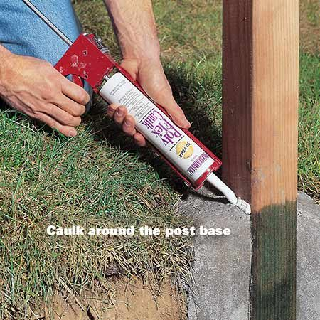 <b>Caulk around the fence post base</b><br/><p>Apply high-quality exterior acrylic latex caulk, or silicone specifically designed to adhere to concrete, at the base of the post.</p>