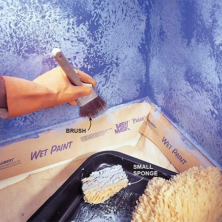 <b>Photo 3: Dab the edges</b></br> Dab paint into corners and along the edges of the wall with a paint brush (2-in. or smaller) or a small piece of sponge torn from the full sponge.