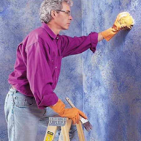 <b>Photo 5: Third color</b></br> Sponge on the third color. We applied our third color very lightly, with the sponge almost dry, to give the wall a hazy appearance. We also kept a brush handy to dab up paint in spots where we applied it more heavily than we wanted.