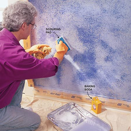 <b>Photo 6: Distress the walls</b></br> Scour areas using water and a synthetic scouring pad. Scouring is easiest if you do it as soon as the paint is dry to the touch. To remove paint that's completely dry (and tough), put some baking soda on the pad. Rubbing areas down to the base coat this way added contrast to our otherwise subtle wall. It also gives you a chance to rub away any drips, blotches or other goofs