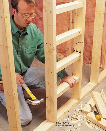 <b>Photo 1: Screw or nail blocks between studs or joists</b></br> <p>To make these blocks, we cut 2x4s to a width of 3-1/8 in to create recessed butt joints on both sides of the wall. In areas where you won't be hanging drywall on the other side (ceilings and exterior walls, for example), you can use 2x2 blocks. On walls, you'll need four blocks for each butt joint. On ceilings, install five blocks. Chisel away part of the sill plate so the lower edge of the drywall can bend inward.</p>