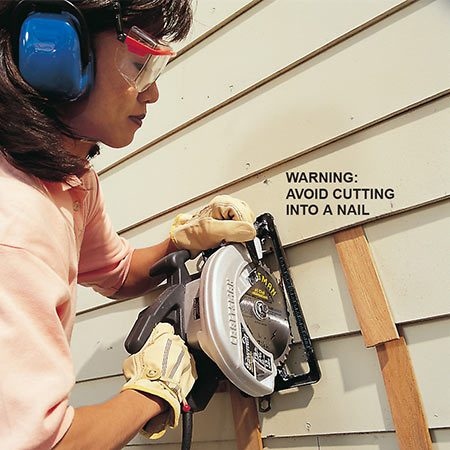 <b>Make the first cut with a circular saw</b></br> <p>Cut out bad sections with a circular saw or even a sharp utility knife. Be sure to stagger the joints (see <b>Photo 1</b>). Most hardboard siding is 7/16 in. thick, so set your blade depth carefully to avoid cutting into other courses. Use shims to lift the boards so you can easily get at the one you're cutting.</p>