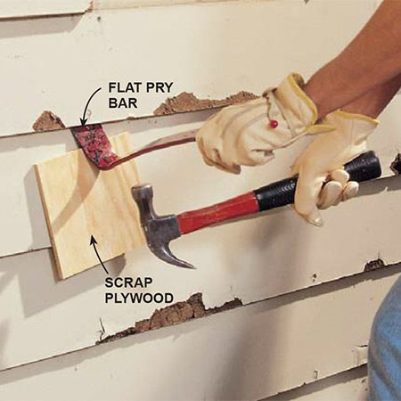 <b>Pry off the rotted boards</b></br> <p>Remove rotted boards with a flat pry bar. Protect sound siding with a scrap piece of 1/4-in. plywood. After you remove the rotted courses, use a small hacksaw to cut any protruding nail shanks, or if you have a very strong grip, use a good pair of wire cutters.</p>
