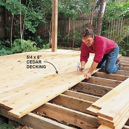 <b>Photo 4: Nail the decking</b></br> <p>Nail the 5/4 x 5-1/2 in. decking (D) to the tops of the joists with 10d finish nails. If your decking feels moist when you're nailing it, butt the sides tight. If the decking feels dry, leave a 1/16-in. space between the boards for expansion during wet weather.</p>