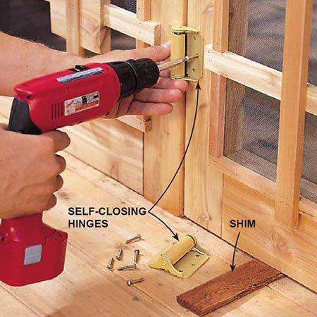 <b>Photo 18: Install the operable doors</b></br> <p>Attach the freeswinging doors to the stationary doors with self-closing face-mounted hinges. Use three hinges per door and make sure each door has a bit more than 1/8-in. clearance on all sides.</p>