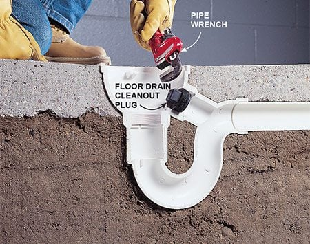 <b>Photo 3: Remove the cleanout plug</b></br> <p>Unscrew the cleanout plug in the side of the floor drain with a pipe wrench, slip-joint pliers, or as a last resort, by chiseling it out with a cold chisel.</p>