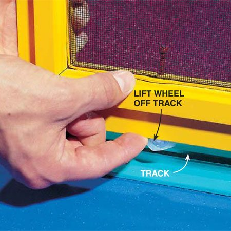 <b>Photo 2: Lift the wheel out of the track</b></br> <p>Lift one wheel off the track using your finger or a screwdriver. With the wheel raised, pull the corner of the frame out of the track. Do the same at the other corner and then remove the door by pulling it down and out of the upper track.</p>