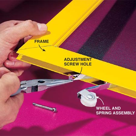 <b>Photo 3: Remove the wheel</b></br> <p>Remove the adjustment screw and pull the wheel and spring assembly out of the frame.</p>