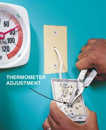 <b>Photo 1: Adjusting the thermometer</b></br> <p>On the backside of the thermostat, directly behind the mercury switch and coil on the front, you'll find a small metal nib (some models have a slot for a screwdriver). Use this to adjust the thermostat's thermometer, using a regular thermometer as a guide.</p>