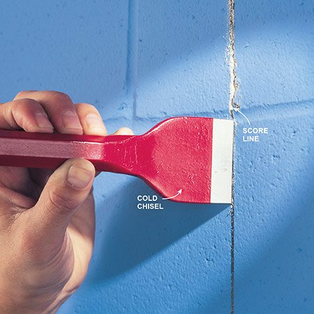 <b>Photo 2: Cutting hollow concrete block—first, score the line</b></br> <p>If your cut doesn't need to be exact, use a cold chisel and hand sledge to cut the concrete. Score the length of the cut three or four times with the chisel. A circular saw with a masonry blade can also be used to either score or completely cut through the block.</p>