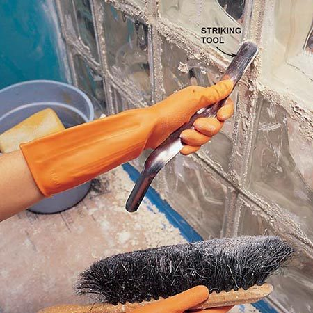 <b>Photo 6: Strike the joints</b></br> <p>Strike joints by dragging a striking tool over the joints about a half hour after setting. Use a soft brush to dislodge loose grout.</p>