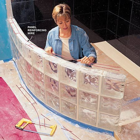 <b>Photo 7: Add reinforcing</b></br> <p>Lay reinforcing wire in every other horizontal row. Cut out small lengths of the side leg of the panel bracing to make bends for curved walls.</p>