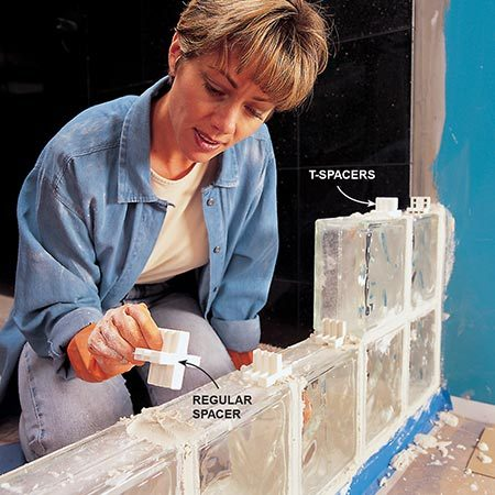 <b>Photo 8: For straight walls, use plastic spacers</b></br> <p>Slip plastic spacers into the wet mortar before laying the next bed of mortar.</p>