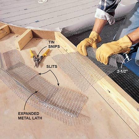 <b>Photo 10: Add the metal lath</b></br> <p>Cut and lay in galvanized expanded metal lath on top of the liner just short of the cement board edges. Bend 12-in. x 3-ft. lengths of lath over a 2x4 for curb reinforcement pieces. Keep the height barely under the form heights. For a curved curb, make a series of slits every 10 in. to help it bend to the shape of the hardboard form.</p>