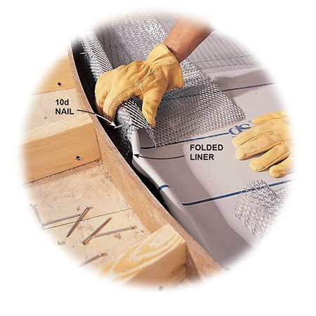 <b>Photo 11: Form the curb</b></br> <p>Fold the vinyl liner and drop the pre-bent curb lath over the top of it. Poke a galvanized 10d nail through the lath and top edge of the liner to keep it from collapsing while you pack the curb with mortar.</p>