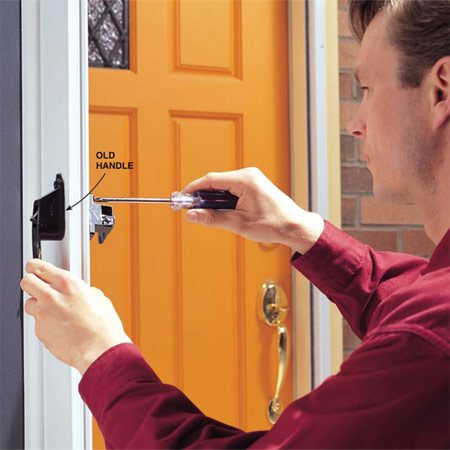 <b>1. Remove old handle</b></br> Remove the old storm-door handle by unscrewing the two screws that hold the two halves together.