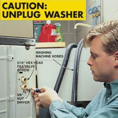 <b>Photo 2: Release the fill valve</b></br> <p>Use a 5/16-in. nut driver to remove the hex head sheet metal screws that hold the valve to the washer.</p> <p><strong>Caution:</strong> Unplug the washing machine!</p>